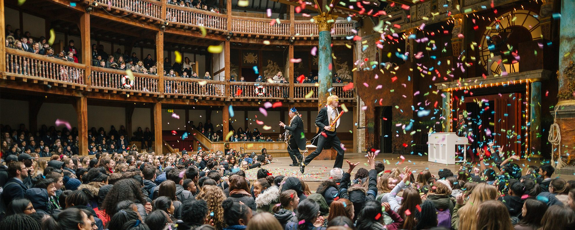 Sir Toby and Sir Andrew from Twelfth Night, dance around the stage as colourful confetti rains over them and the groundlings in the yard.