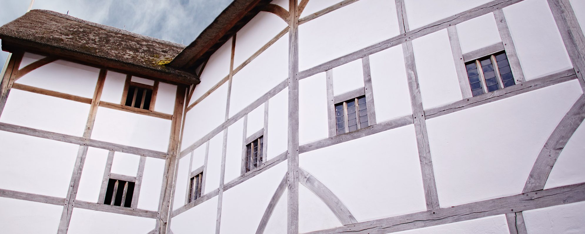 A close up of a white timber framed building