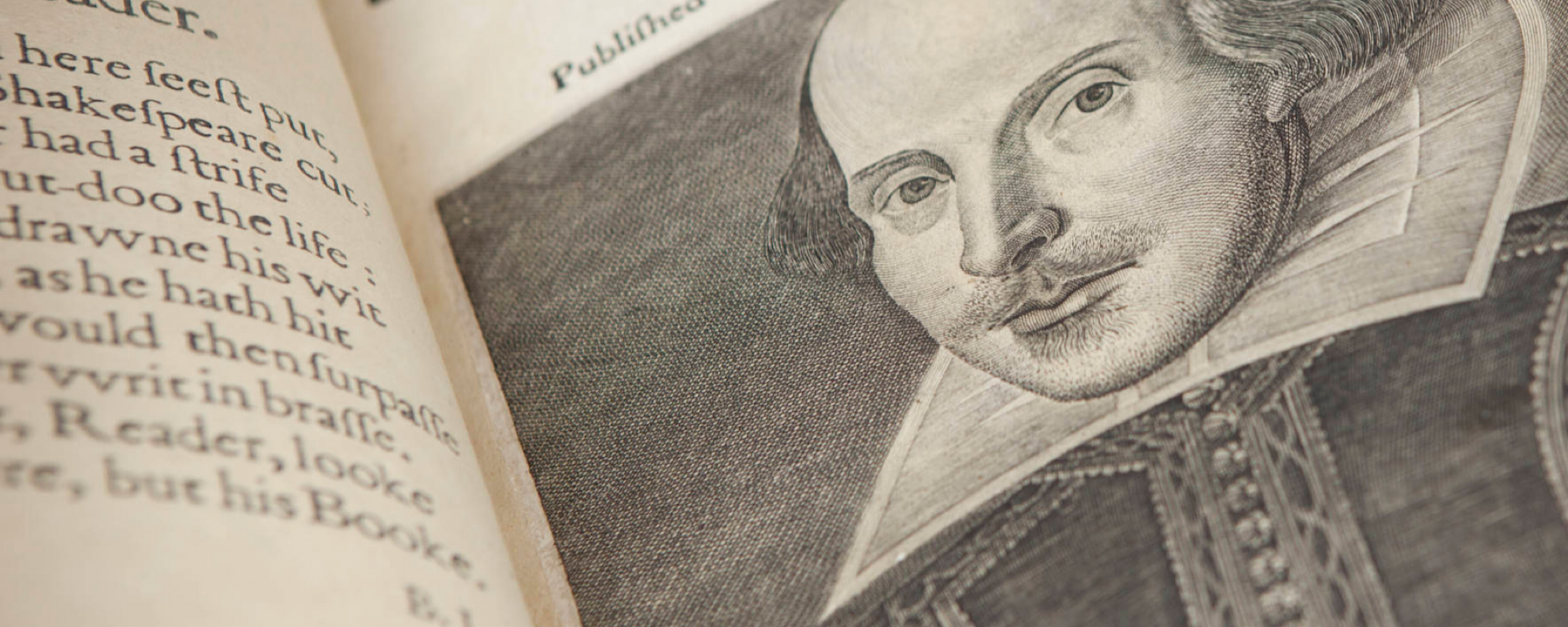 An open page of a book shows an illustration of the face of William Shakespeare