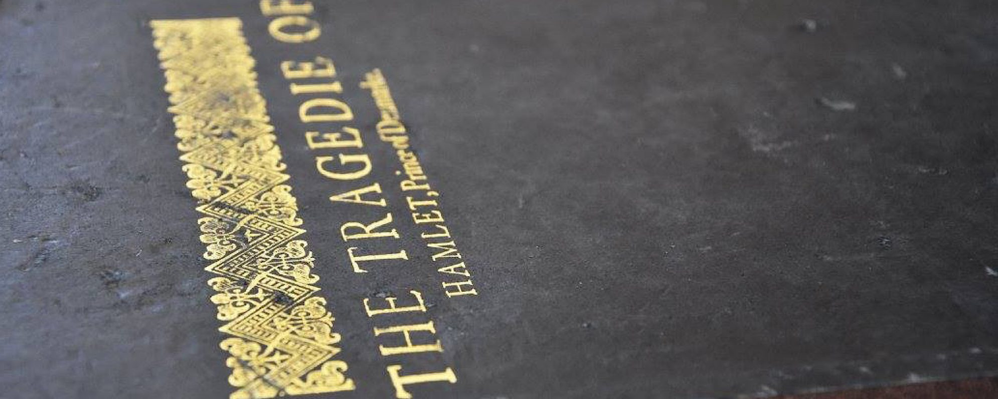 A black book with a gold title on it which reads The Tragedie of Hamlet of Denmark